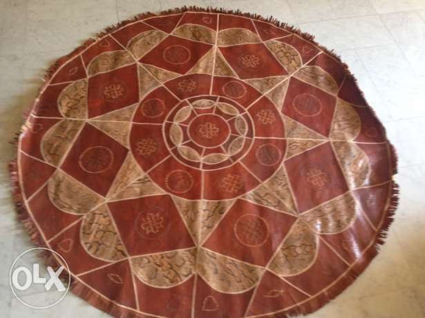 leather and snake round carpet 1.80 M diametre