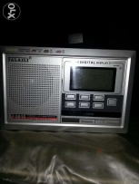 Digital Radio with clock and alarm extra bass and treble in good cond.