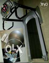 Treadmill like new and Core Secrets Fitness Ball, DVD workout from USA