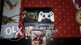 Ps3 super slim with 2 controllers and 5 games!
