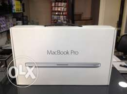 """Brand New """"not used"""" MacBook Pro last peice at 975$ only for OLX users"""