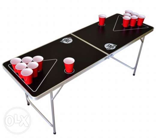 beer pong table, cups and balls.