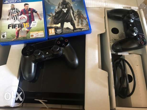 play station 4 (ps4) with 2 controllers and 2 games
