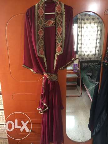 elegant abaya with dress under it