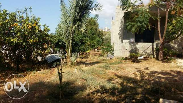 land with house in jbeil aamchit