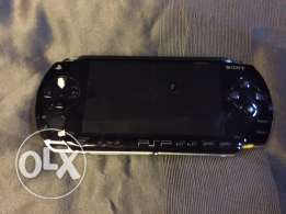 PSP with charger and case