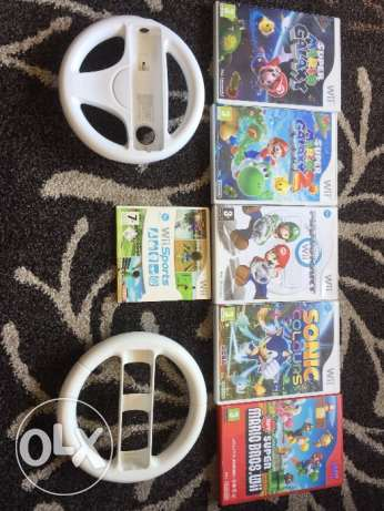 6 WII games (one 10$, all 50$ / one wheel 5$)