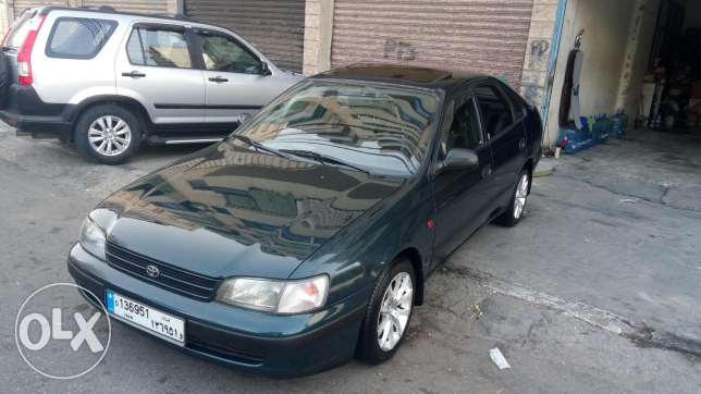 toyota carena 3 abs fat7a ,jnouta 15 super cherki 5er2a one owner