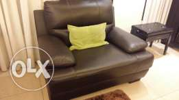 2 leather couches, very good condition plus their carpets as a gift