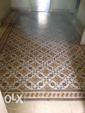 One hundred year old original mosaic stones for ground