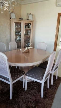 Dinning room with 6 chairs and closet excellent condition