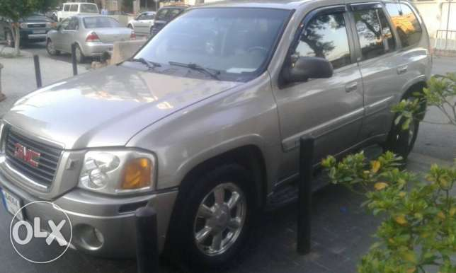 Gmc envoy for sale with plate number (64064)