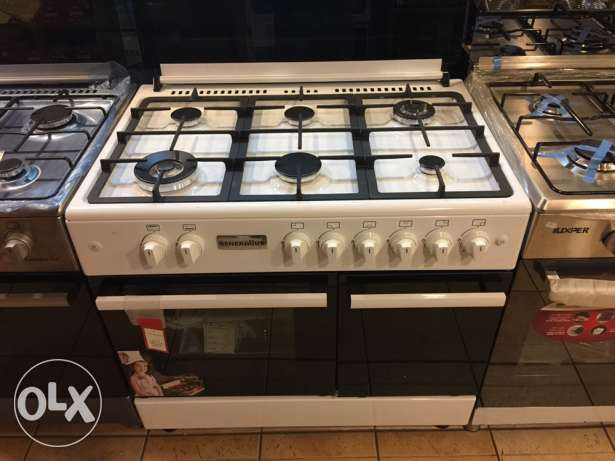 gas oven 6 eyes with one year warranty NEW