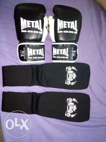 Boxing gloves and leg pads for sale
