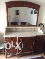 Marble countertop dresser with mirror.
