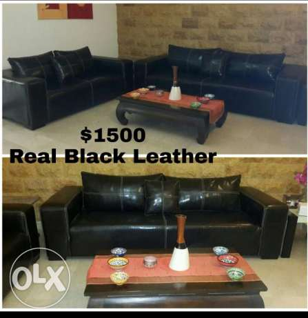 Leather couches. Center table included.
