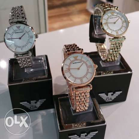 Golden EA jewelery watch for classy women