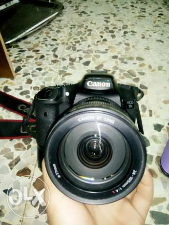 7d in good condition with lens 24'105 w grip w charge w bag w memory المية و المية -  2