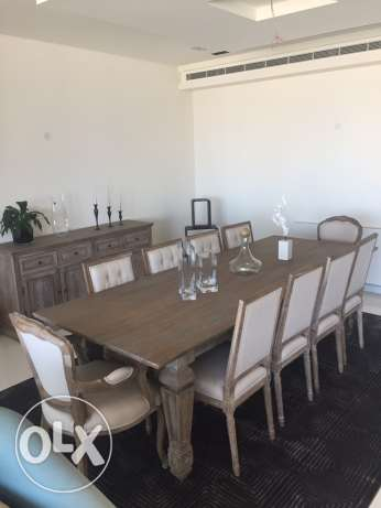 brushed wood dinning table with 10 chairs and console