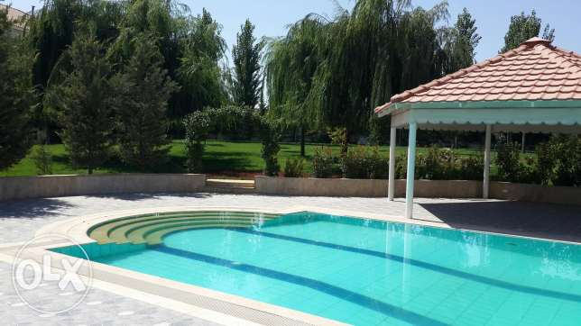 Anjar Villa for sale, triplex, 1100m2, pool, 4000m2 swiss park garden