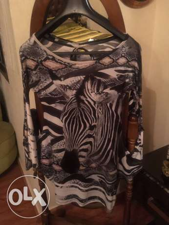 open sleeved long top with zebra design size L