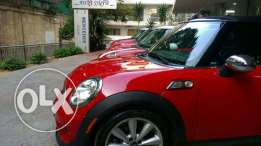 Mini Cooper color red model 2009 milage 63,000