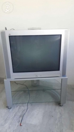 "32"" television with table"