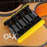 Guitar and piano finger exerciser