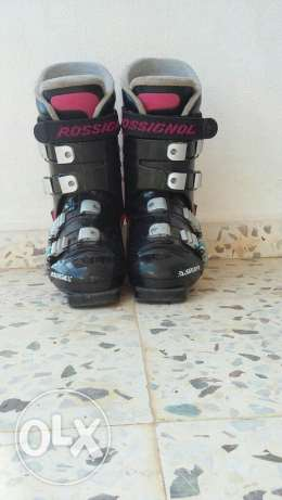 2 pairs of ski and boots