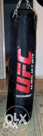 BRAND NEW UFC Punching Bag (120lbs) with Hook, Gloves and Hand Wraps!