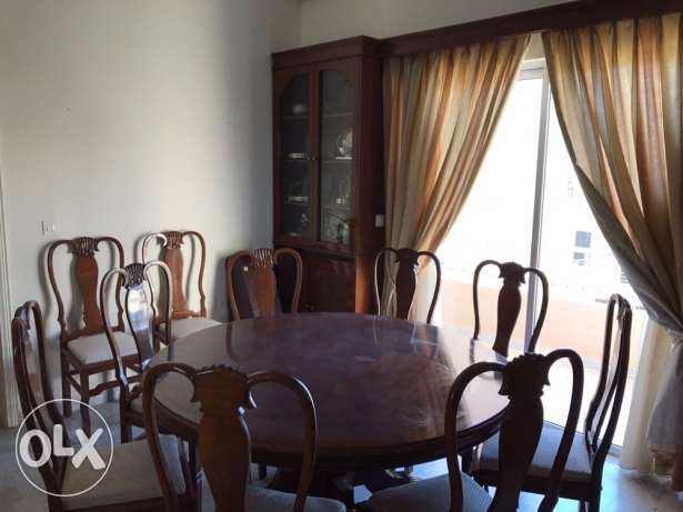 big round table and 10 chairs
