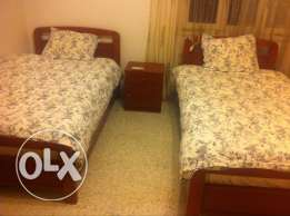 Bed room (2 beds and 1 side table)