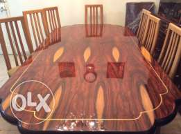 dinner wooden table with new chairs