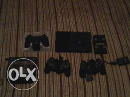 A Sony ps2 with 3 controllers and amemorycard+a multitab+23cds