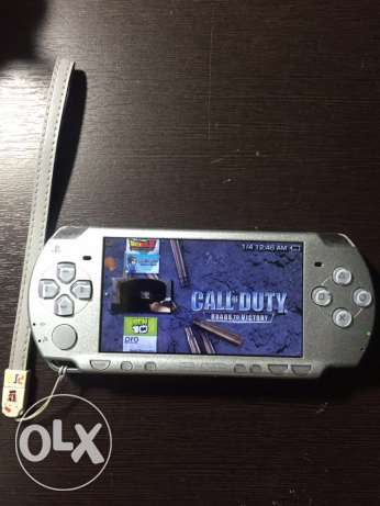Psp 2004 silver + charger + memory card 4 GB that has 12 games