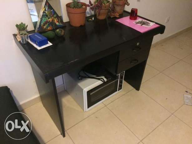 Desk, same condition as was bought in. Table