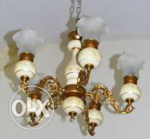 Chandelier brass white lamp , lighted by electricity. Width 70 Cm.