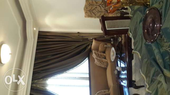 Salon + center table + dinning room + curtain