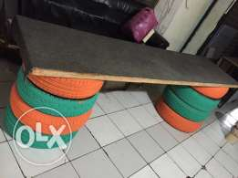 hamdmade table with 8 tyres as base