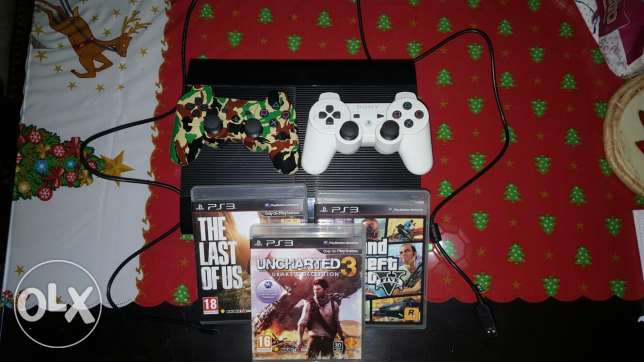 Ps3 super slim with 2 controllers and 3 games!