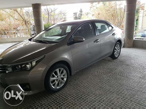 toyota corolla 2014 superior package still under company warranty . حارة حريك -  5