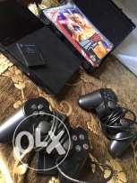 ps2 + 2 dualshock controllers + almost 30 cds and a box