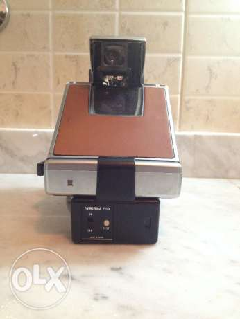 Polaroid SX-70 land camera + flash