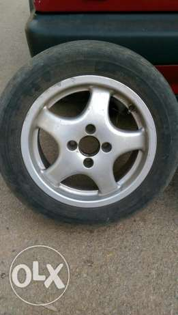 4 rims (14 inch) with tires.