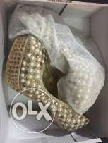gold heels with pearls