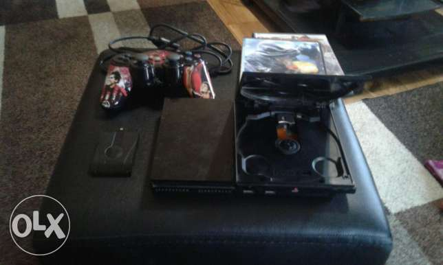 play station 2 all wires + wireless console + 2 games good condition