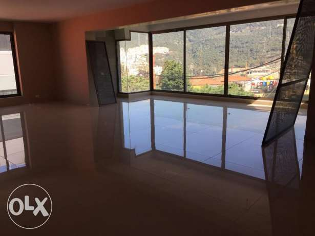 Luxurious apartment located in Fanar beautiful pine trees surrounding