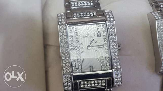 Brand new not used two silver BROGEH watches for both man and woman