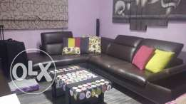 Living room + table + tv wall unit + curtains + wall paiting