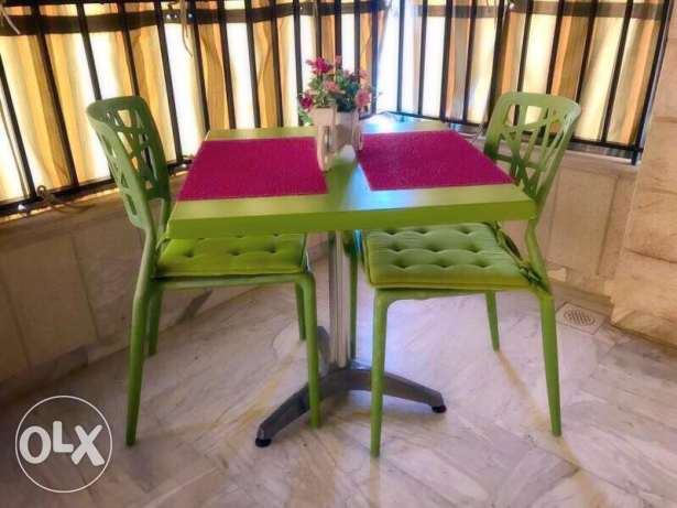 outdoor furniture: table and 2 chairs + 4 resine pieces